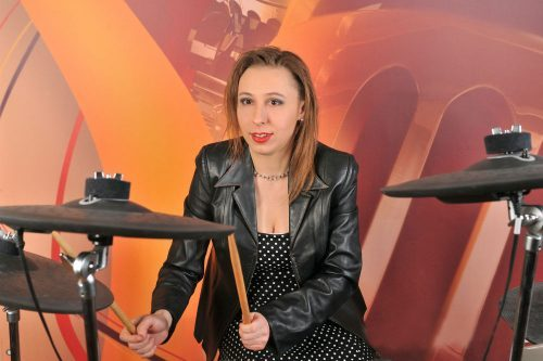 lady playing electronic drum set